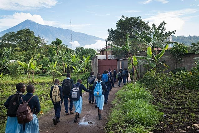 Monday morning: Mt Meru towers over Peter and his friends as they walk from the Moivaro boarding campus to St Jude's Upper Primary campus. They've got a lot to catch up on after all spending the weekend with their families.