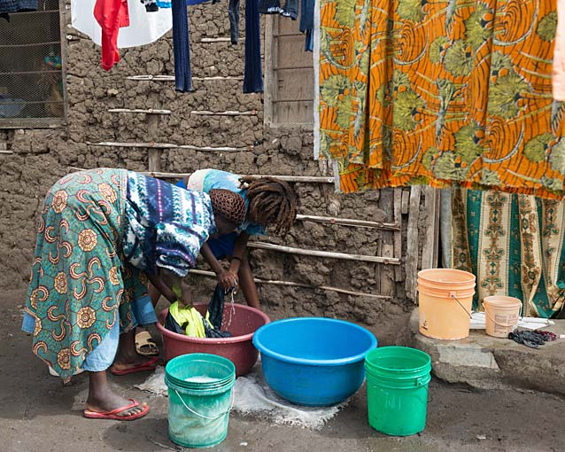 Washing is done outside in buckets that they fill with water from a tap that is a few metres from their house.