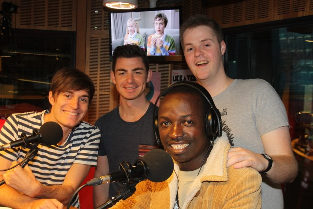 Felix catching up with Triple J presenters Tom and Alex and their producer, Ollie.