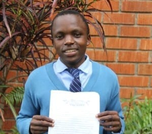 Ebenezer holds his essay