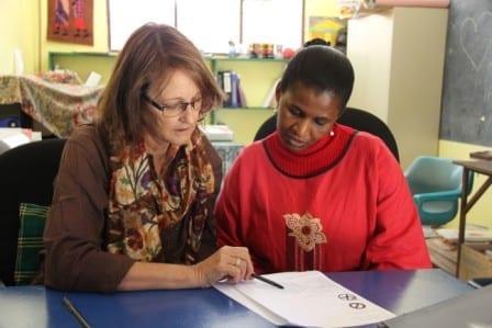 Lynn McMahon discusses curriculum integration with teacher Grace Saguma