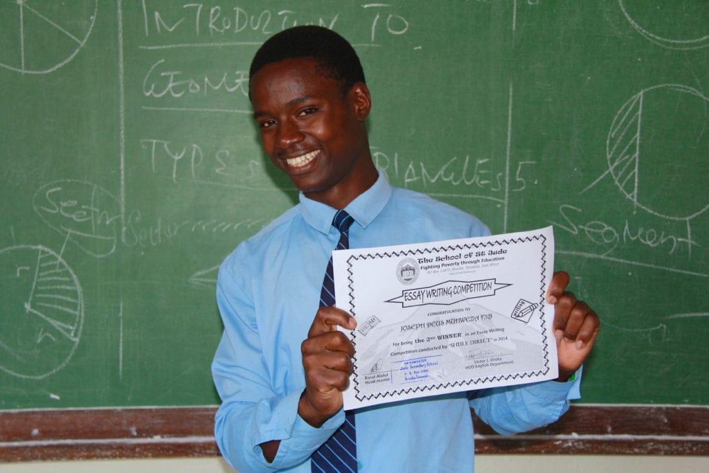 Joseph proudly showing his award