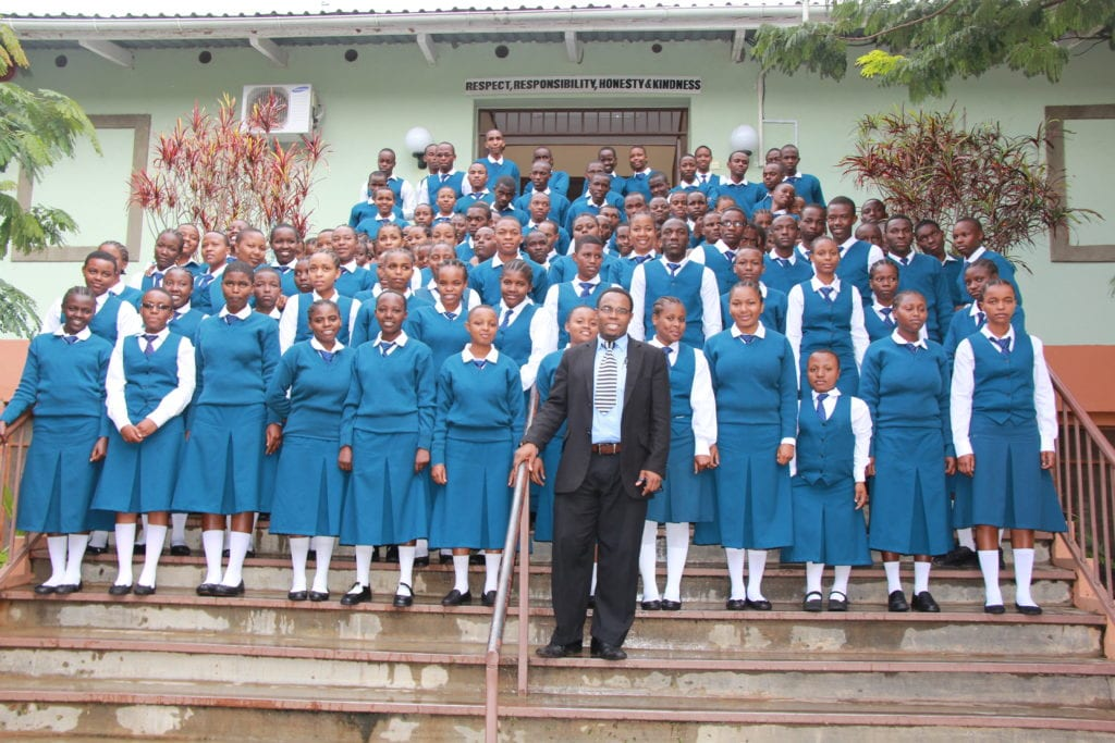 St Jude's Secondary Headmaster Rasul Abdul with Form 5 students at St Jude's Smith campus