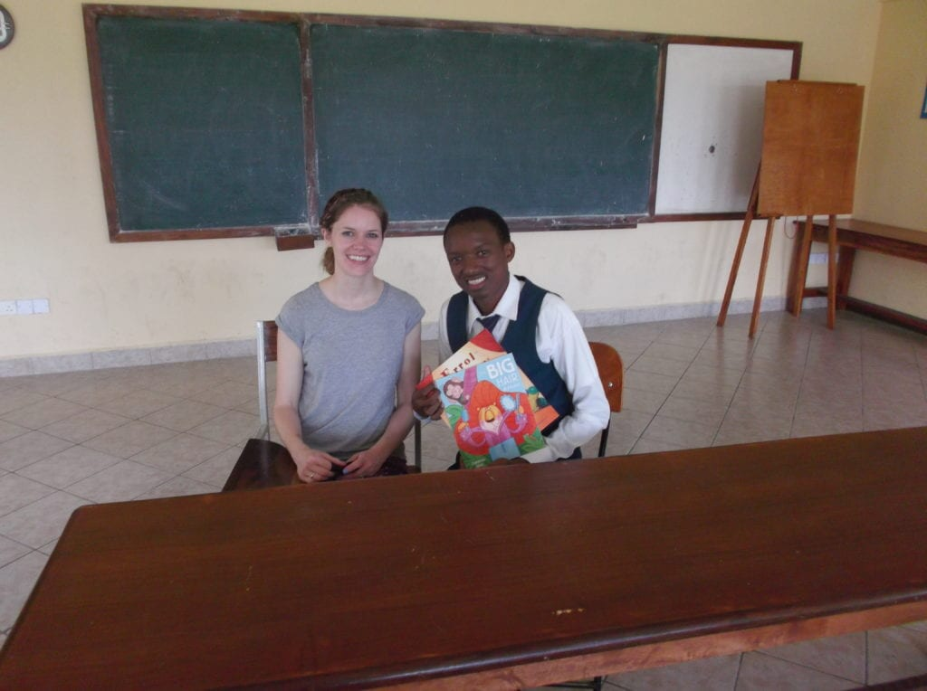 Rachel passing on a few books to Suleiman