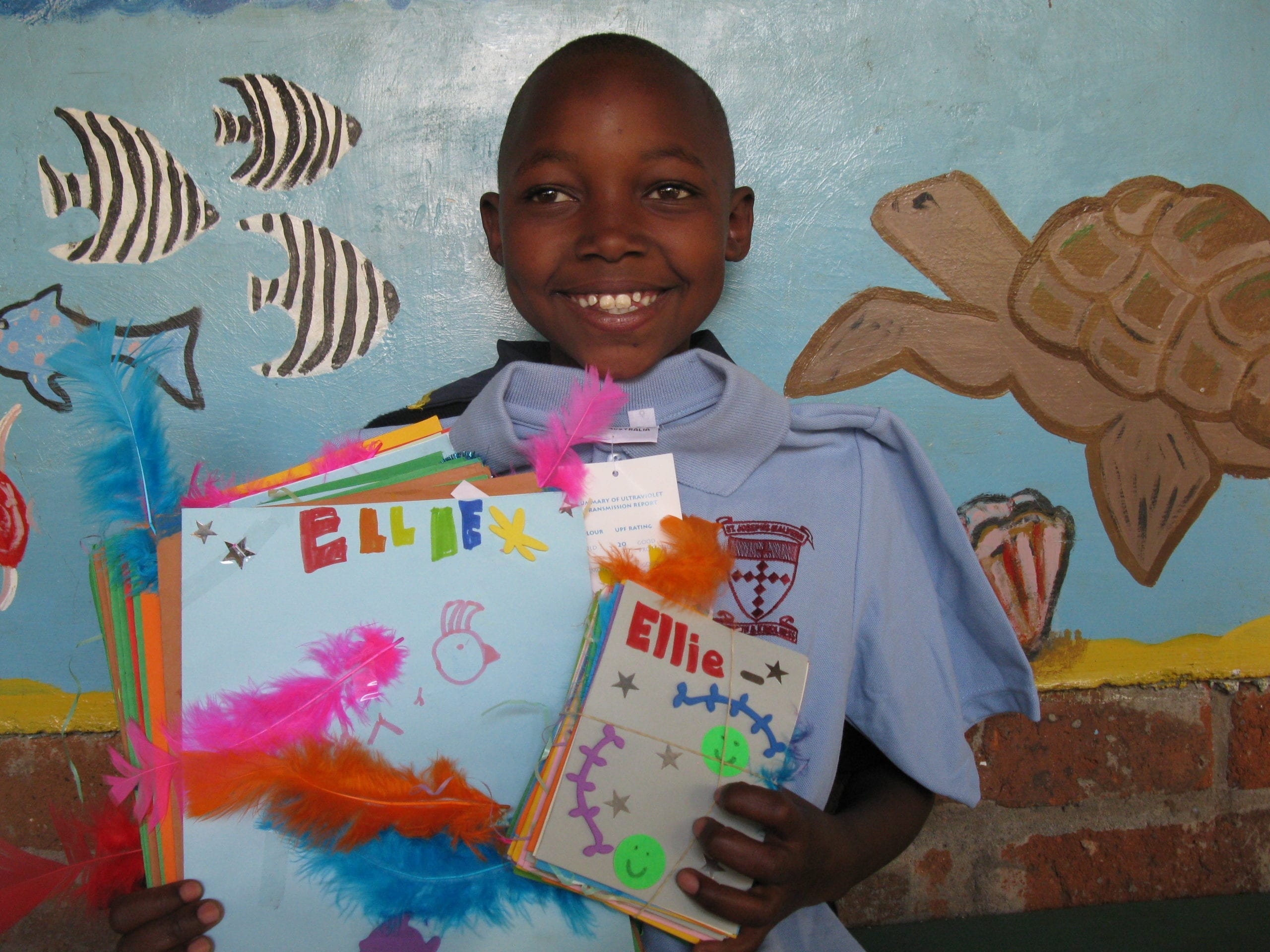 Elifuraha with her cards from the children at St Joseph's Primary School