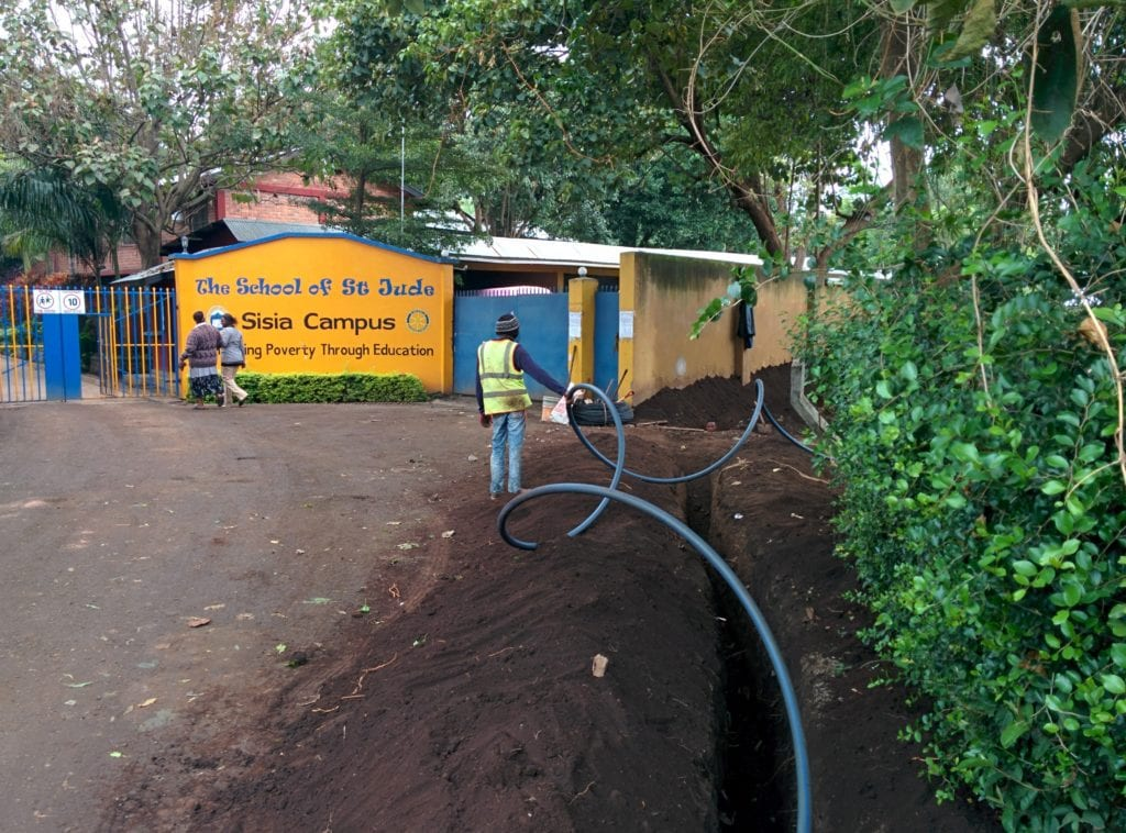 Workers putting in the fibre optic cable at our Moshono campus.
