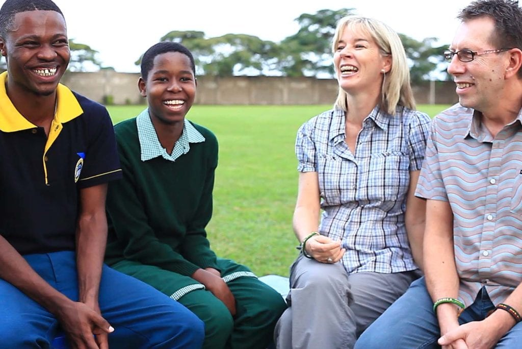 Australians Julie and Kevin Smith share their experiences sponsoring Form 6 graduate Amos (far left) and Form 3 student Faith (second from left).