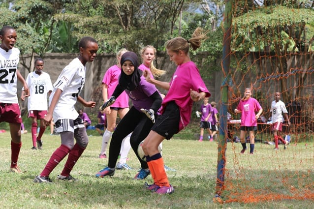 Quick moves: Competition between the girls' teams was no less fierce.