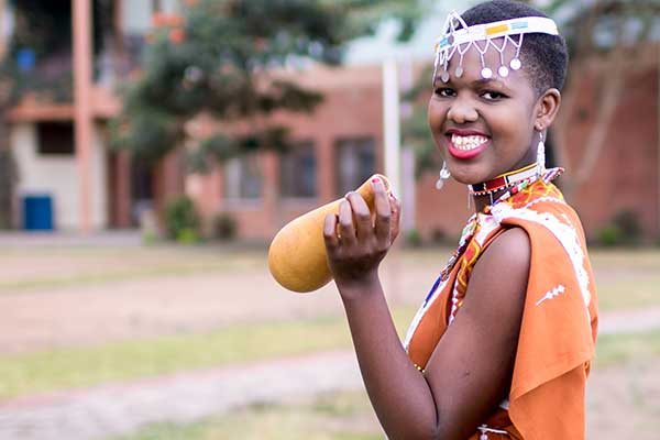 Celebration of the nation: A smiling student rejoices in her Maasai dress before our annual fashion parade
