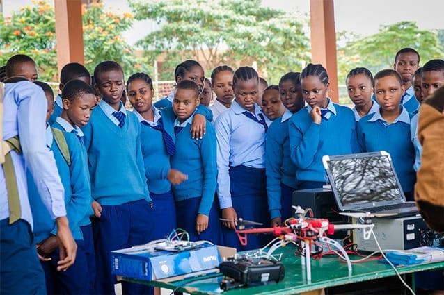 Poachers beware: Students crowd around the quadcopter anti-poaching display.