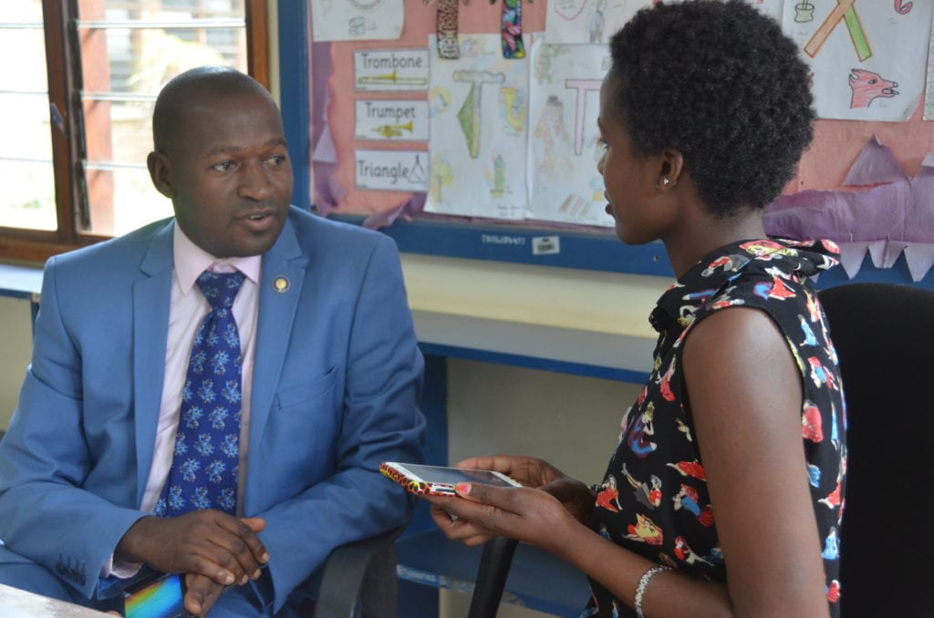 Leading the way: Miriam interviews District New Generations Chair, Francisco Ssemwanga.