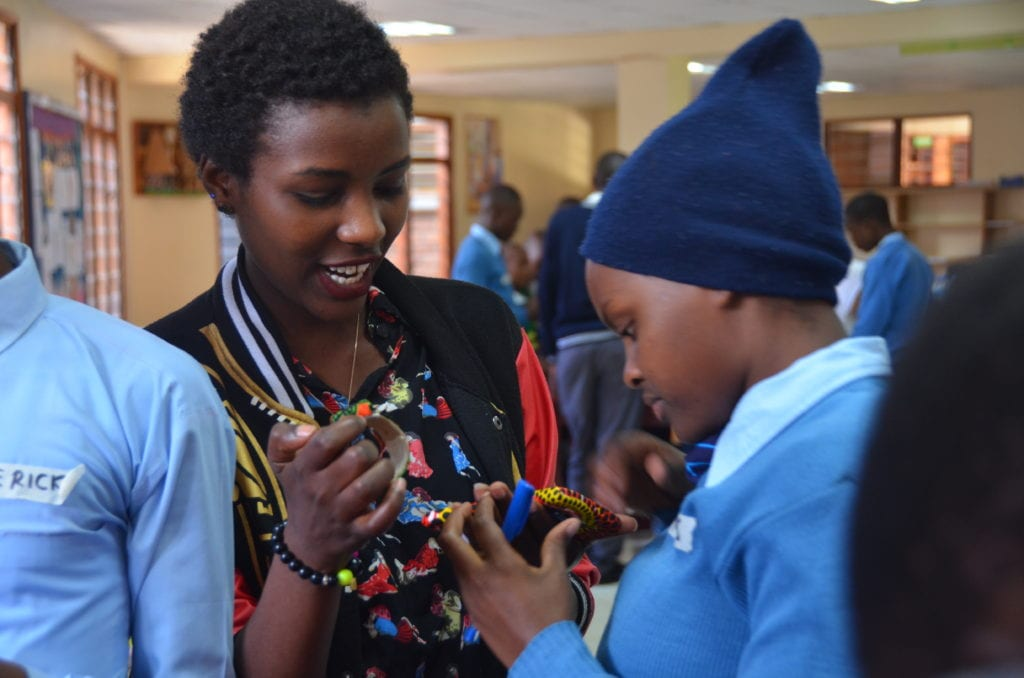 A helping hand: Workshop facilitator, Miriam, supports a student during the interactive session.