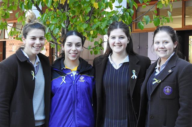Sealed with a bow: Year 12 students Anna, Dimiti, Clare and Maddie sold hand-made St Jude's ribbons.