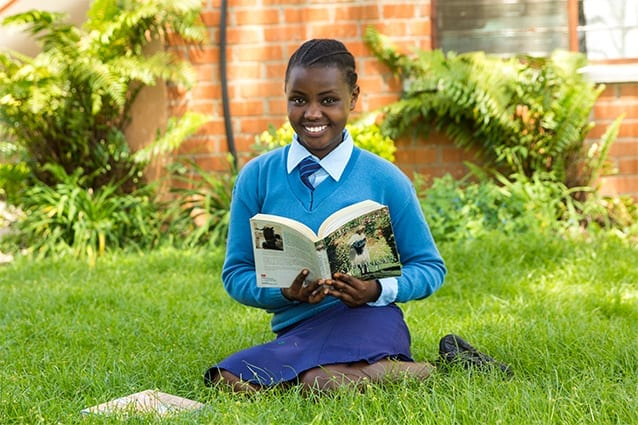 Reading the future: Jenifa enjoys studying hard so she can be a role model for African females.