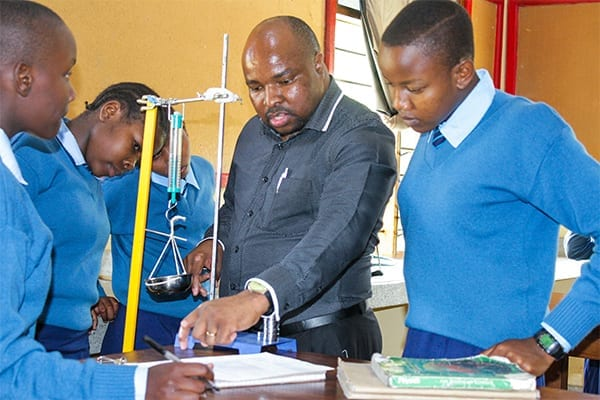 Making the time: Mr Mcharo during his class teaching Form 1 students.