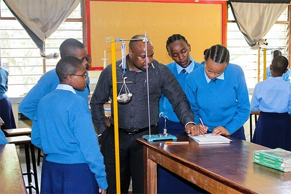 Leading the way: Mr Mcharo advises Form 1 students during his class.