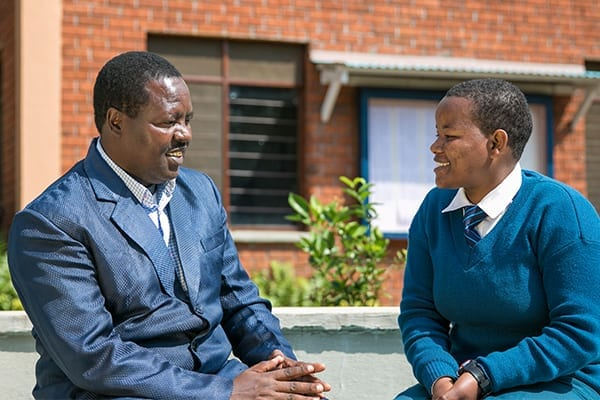 One Year On: Mr Sherwin meets with Form 6 student Febronia, the first Masabeda student to join St Jude's last year.