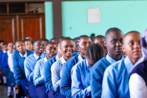 Looking Forward: St Jude's Girls' students Secondary School anticipate a bright future as they watch the celebrations for the official opening on the stage.