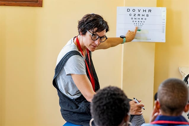K for Koala!: Caroline carrying out an eye examination with a primary student.