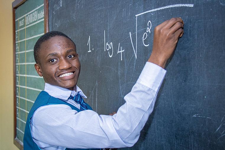 St-Jude-Student-wringing-on-black-board