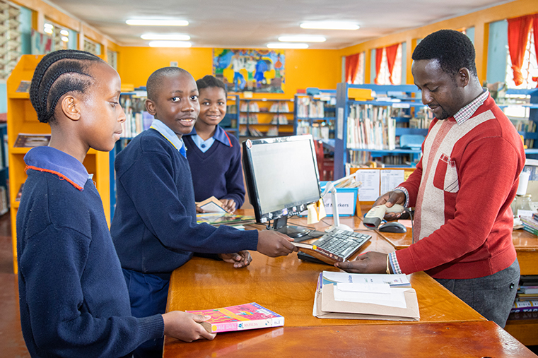 Teacher-and-students-at-St-Jude-Library