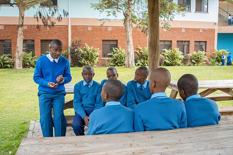 Form 6 students, enjoying a break with his schoolmates